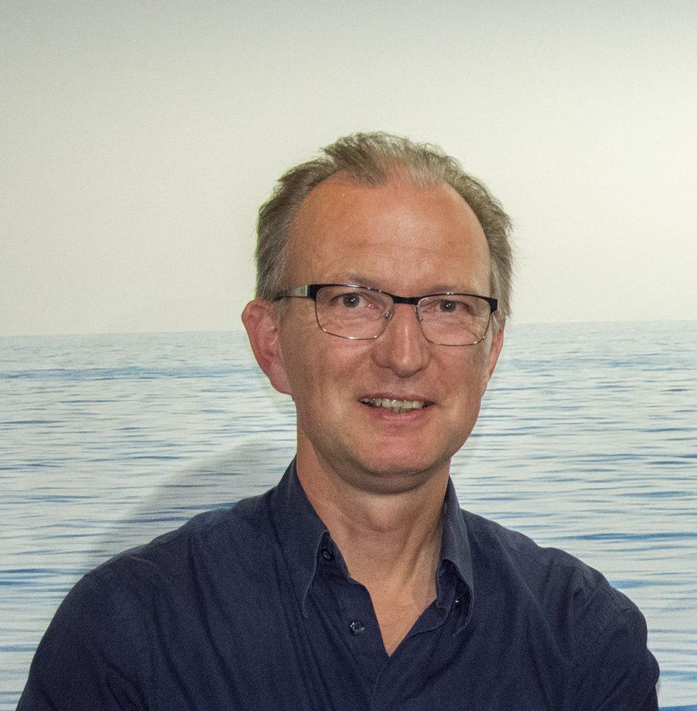 """Portrait von Dr. Erik Lindner, Historiker und Kurator der ausstellung """"Flucht übers Meer - von Troja nach Lampedusa""""."""